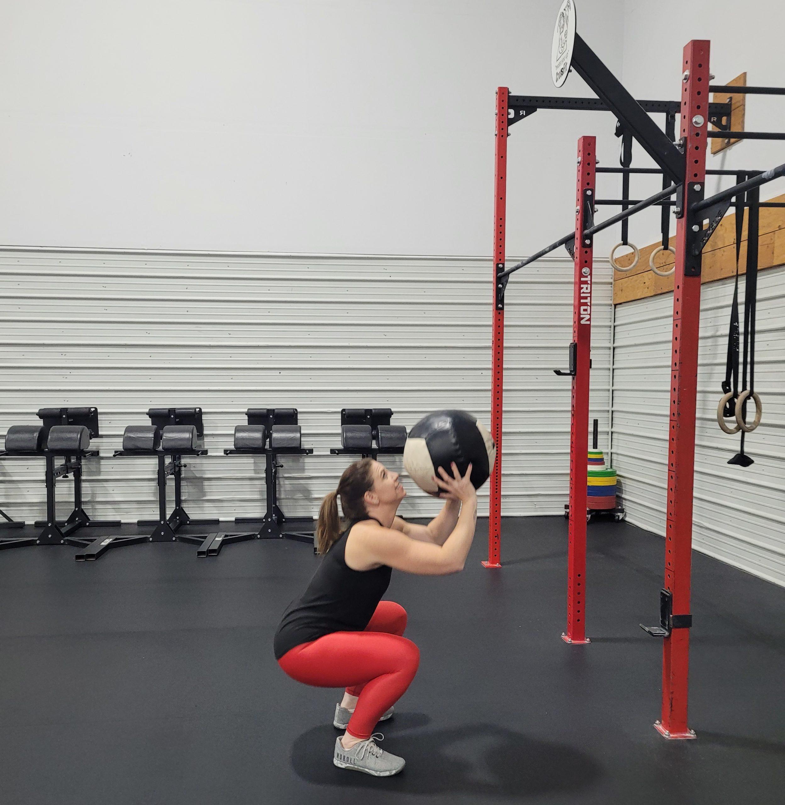 Kayla Passaro performs wall balls