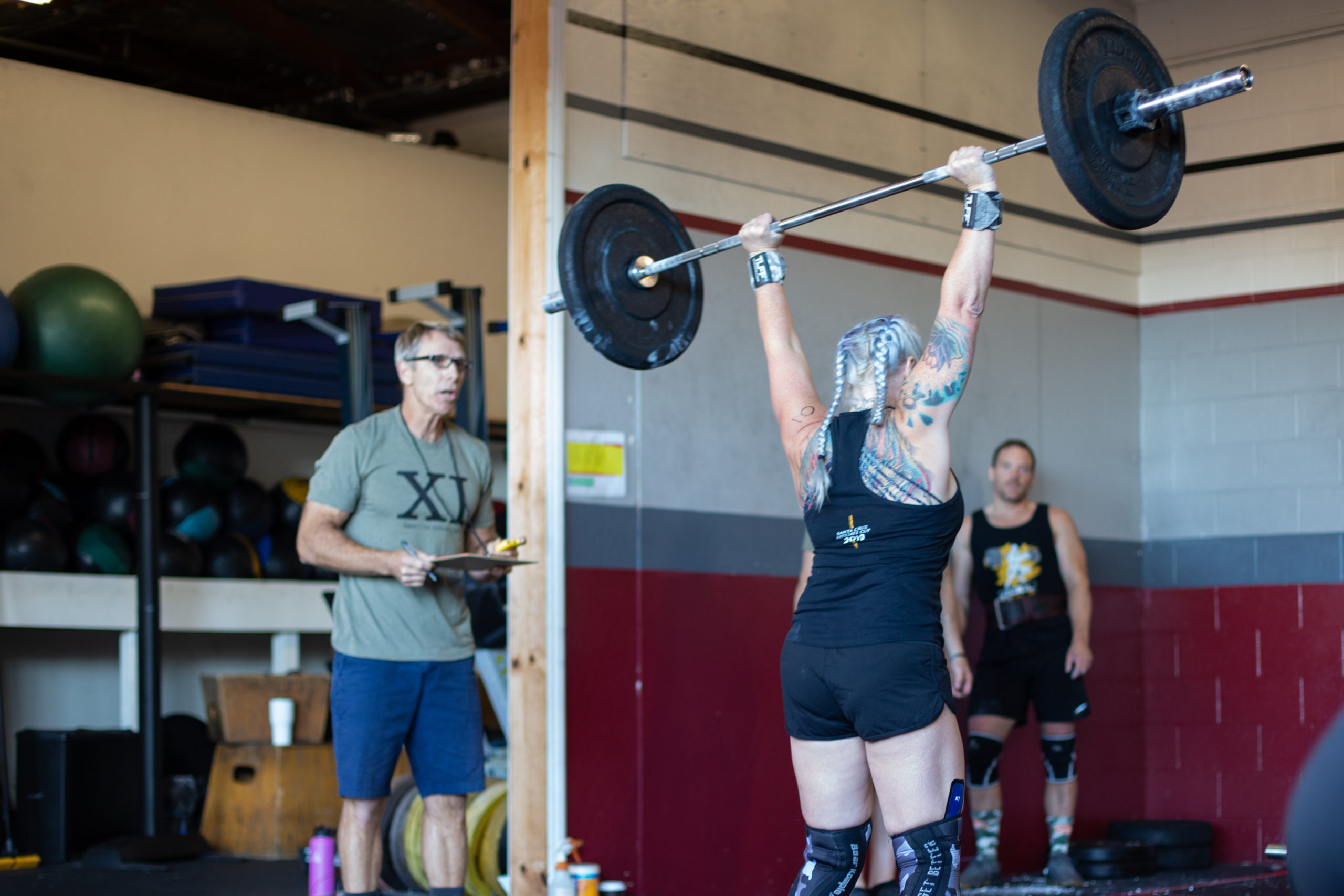 Angie Manson completes an overhead lift.