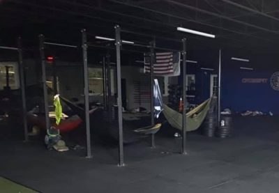 Lineworkers sleep in hammocks suspended from a pull-up rig.